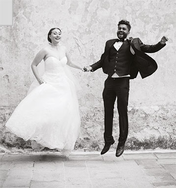 Couple jumping image for wedding brochure